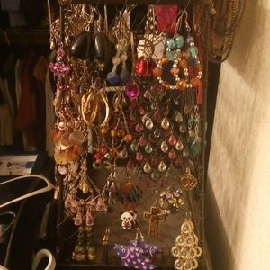 23 pairs of earrings, assorted styles and colors